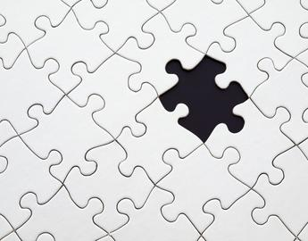 White puzzle with a piece missing on a black background